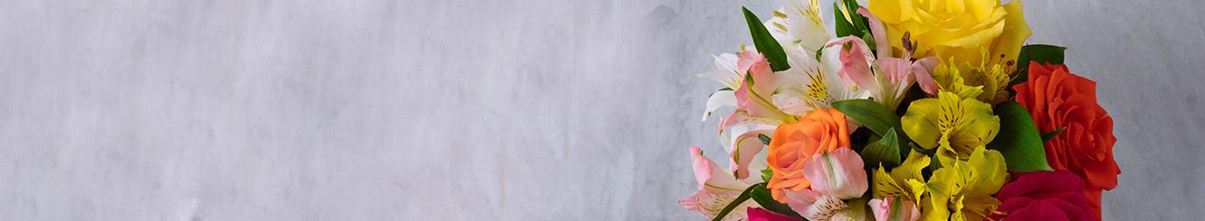 Buquês de Flores e Cestas de Presentes com preço até R$100.